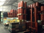 Barrels of honey, hive boxes and ingots of beewax