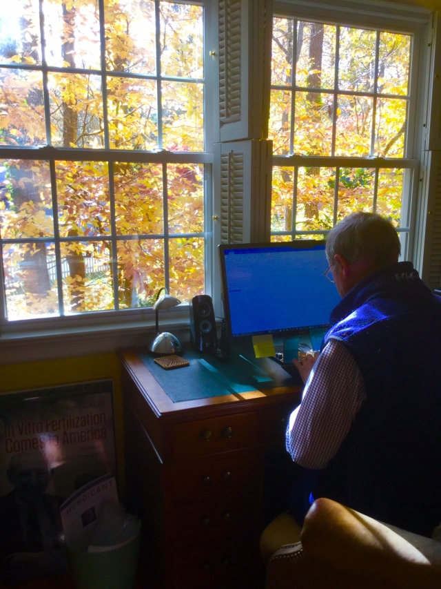 blog writer at his desk